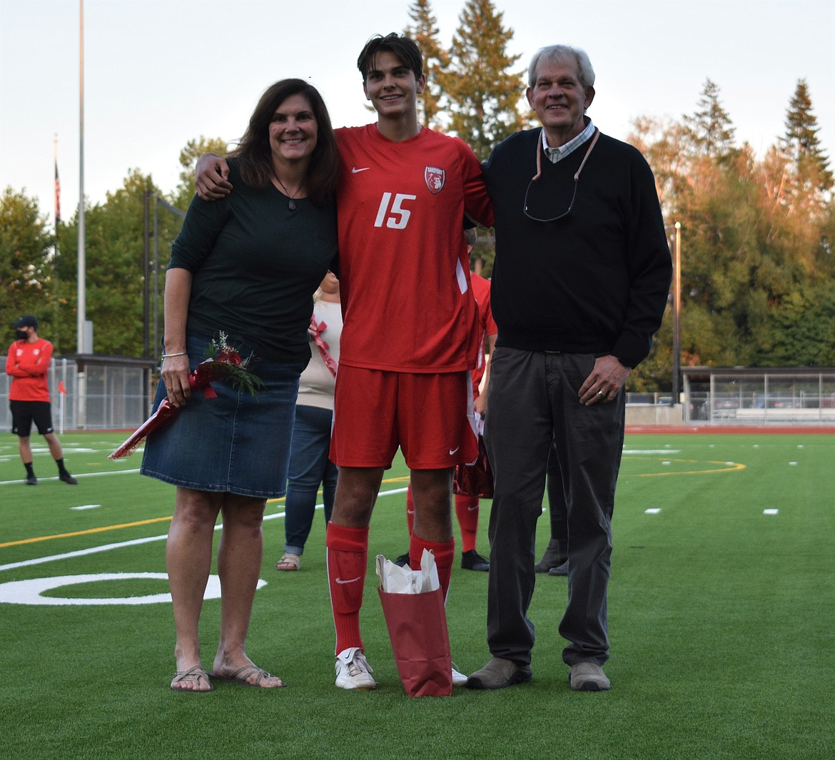 Chris Koch poses for a photo with his family on Senior Night.