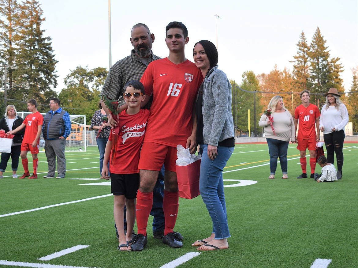 Conagher McCown poses for a photo with his family on Senior Night.