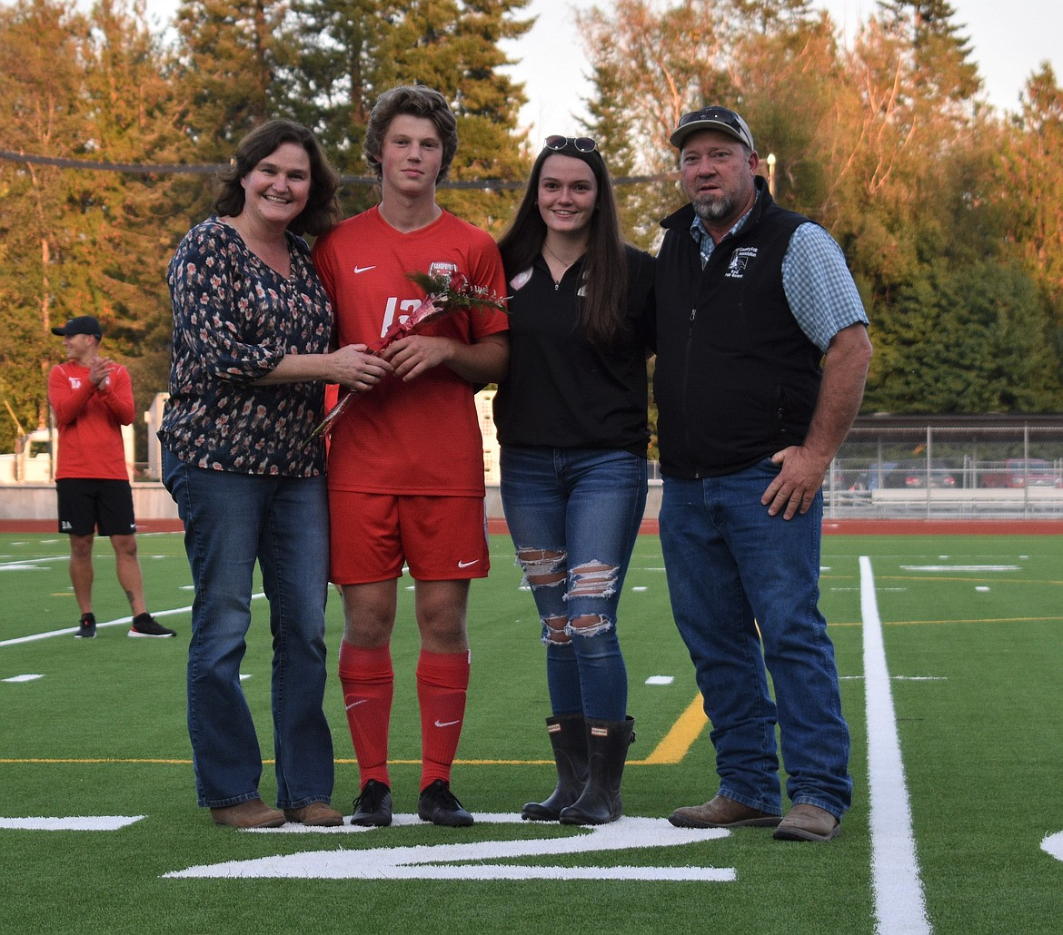 Kris Berget poses for a photo with his family on Senior Night.