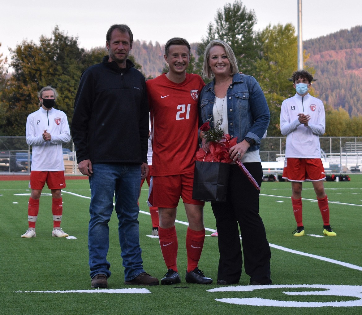 Taylor Beauchene poses for a photo with his family on Senior Night.