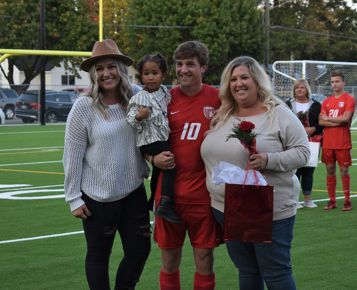 Zander Moore poses for a photo with his family on Senior Night.