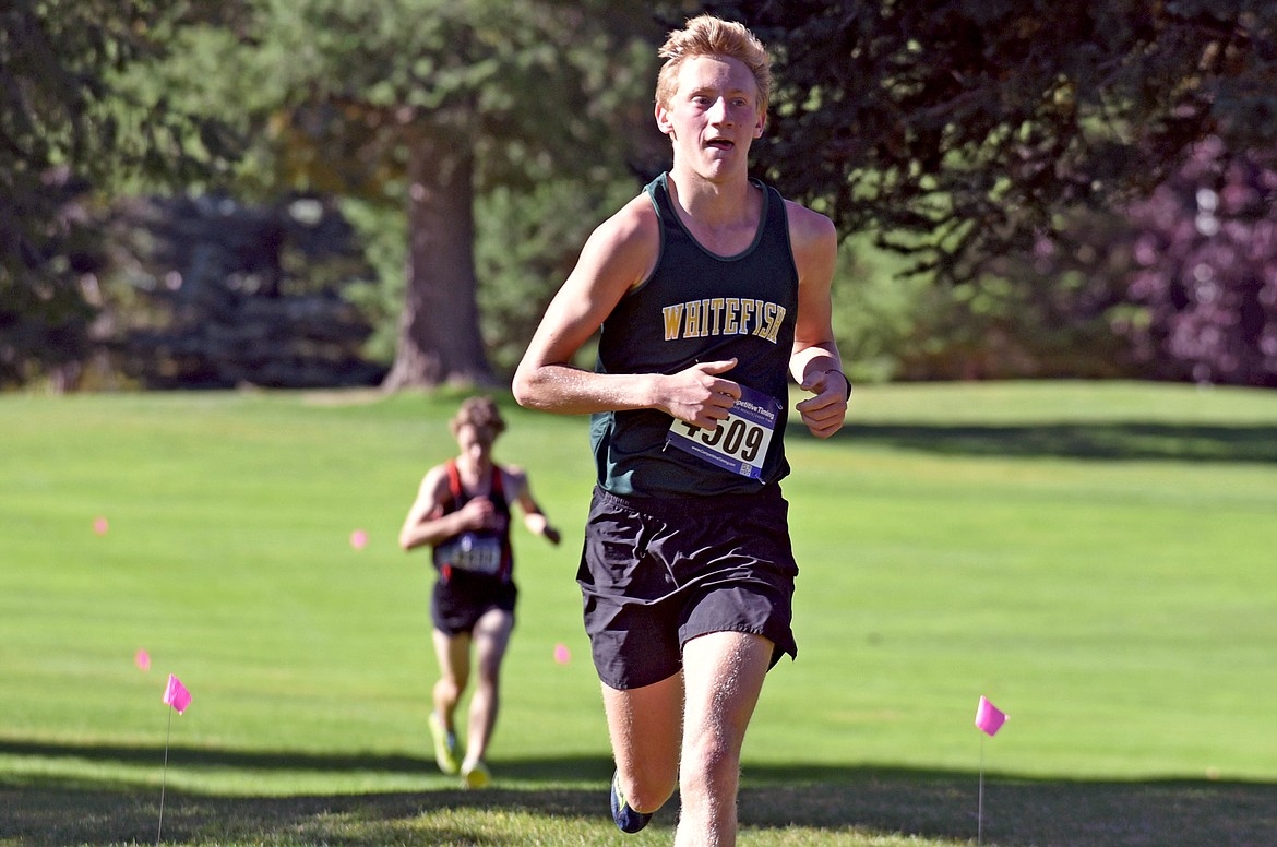 Whitefish runner Ruedi Steiner competes at the Stumptown Triangular at Whitefish Lake Golf Club on Tuesday, Sept. 29. He was the third fastest boy runner for the Bulldogs. (Whitney England/Whitefish Pilot)