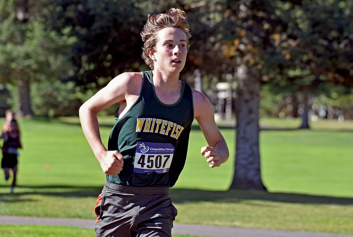 Bulldog Deneb Linton runs to a seventh place finish and was Whitefish's second fastest runner at the Stumptown Triangular at Whitefish Lake Golf Club on Tuesday, Sept. 29. (Whitney England/Whitefish Pilot)