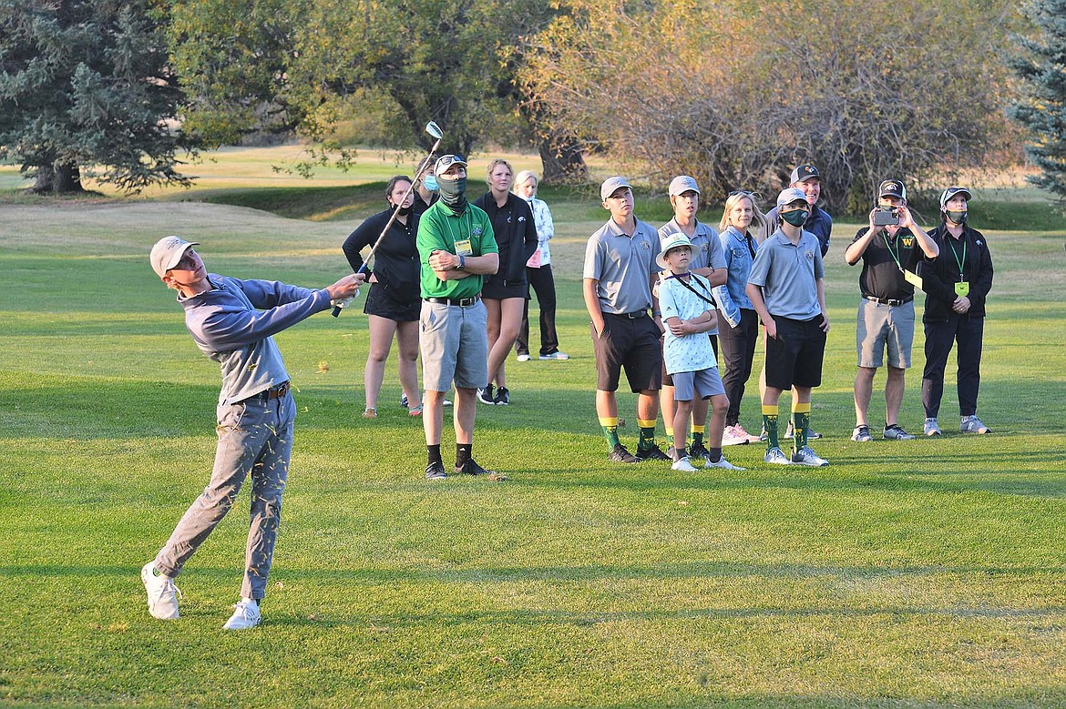 Billy Smith hits his approach shot in the sudden-death playoff Friday against fellow Bulldog Cameron Kahle  in Butte at the Class A state golf tournament. (Jeff Doorn photo)