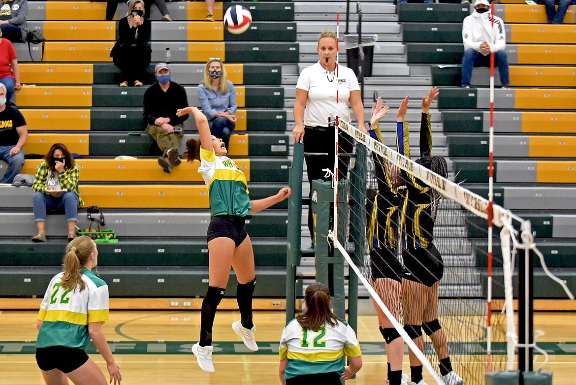Whitefish's Emma Trieweiler goes up against Libby's blockers in the Lady Bulldogs Homecoming match Thursday evening. (Whitney England/Whitefish Pilot)