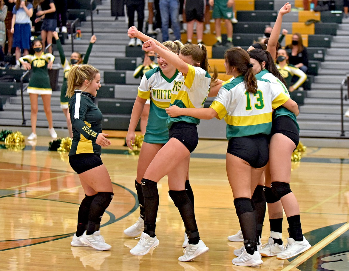 Whitefish Volleyball celebrates its straight-set win against Libby during the Bulldogs Homecoming match Thursday, Oct. 1. (Whitney England/Whitefish Pilot)