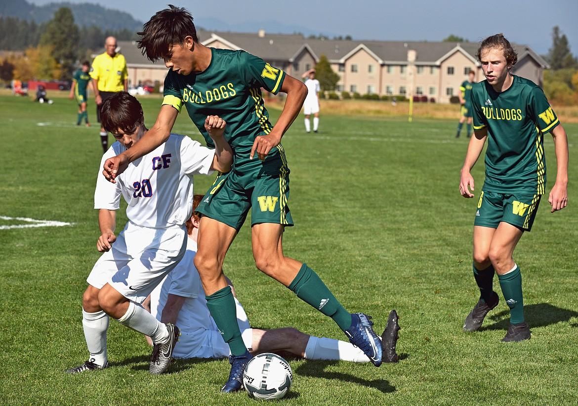 Whitefish senior forward Brandon Mendoza challenges a Columbia Falls player in a game at Smith Fields on Saturday. (Whitney England/Whitefish Pilot)
