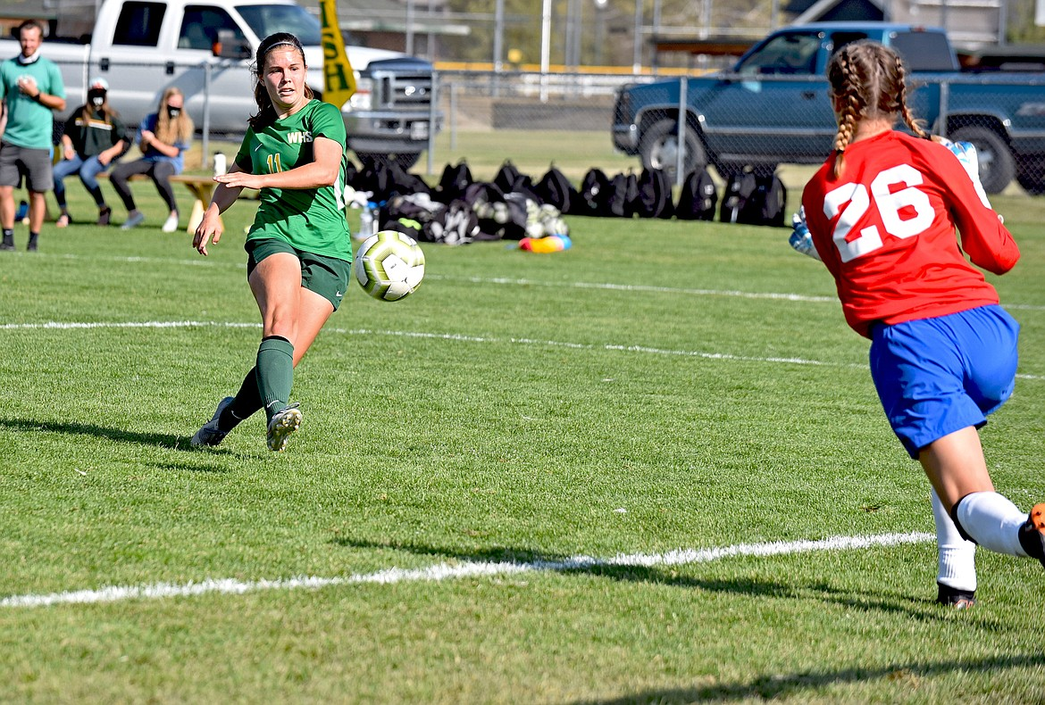 Whitefish midfielder Emma Barron drives a shot against Columbia Falls goalkeeper Nevaeh Carlin in the second half of the rivalry match at Smith Fields Saturday. (Whitney England/Whitefish Pilot)