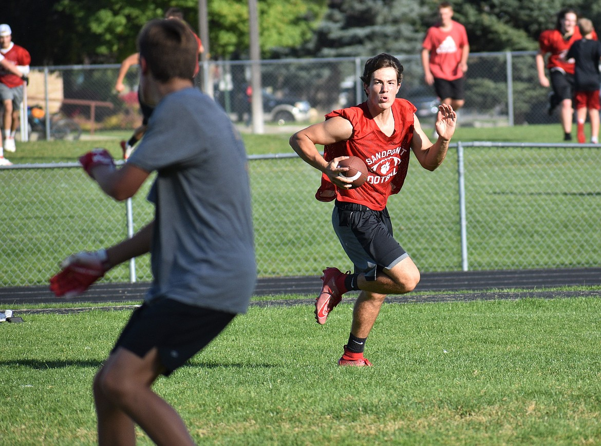 Auggie Lehman scrambles and looks for an open receiver on Wednesday.