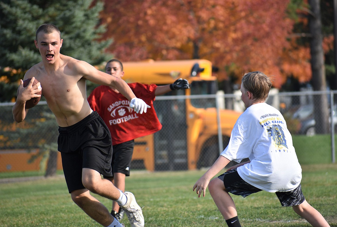 Zac Whittom jukes a middle school defender on Wednesday.