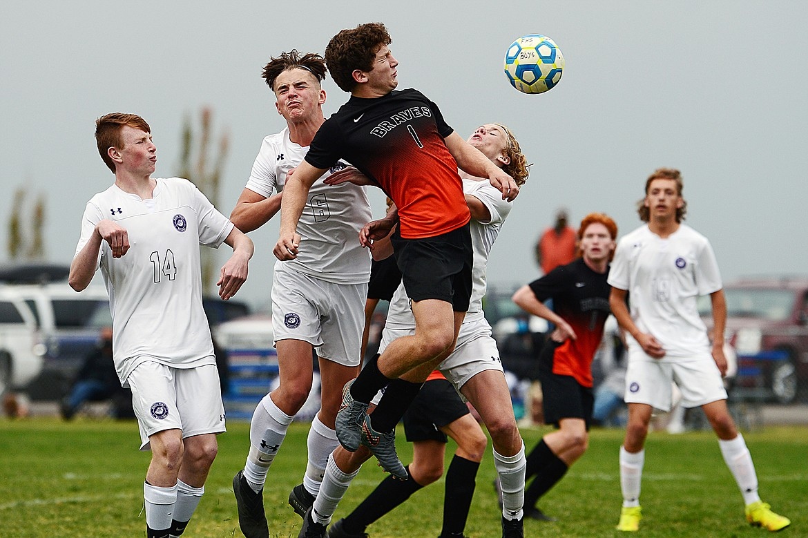 Flathead's Fin Nadeau (1) directs a header towards the Butte goal off a corner kick in the second half at Kidsports Complex on Saturday. (Casey Kreider/Daily Inter Lake)