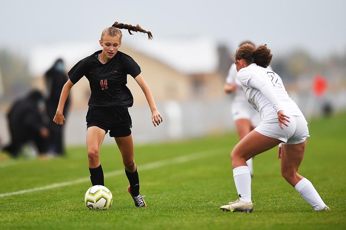 Flathead's Mia Stephan (11) pushes the ball upfield in the first half against Butte at Kidsports Complex on Saturday. (Casey Kreider/Daily Inter Lake)
