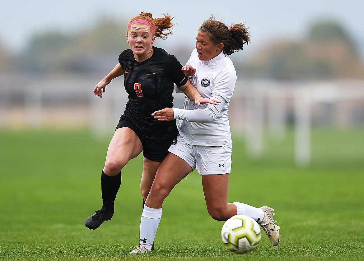 Flathead's Skyleigh Thompson (9) gets past Butte's Taylor Burke (2) in the first half at Kidsports Complex on Saturday. (Casey Kreider/Daily Inter Lake)