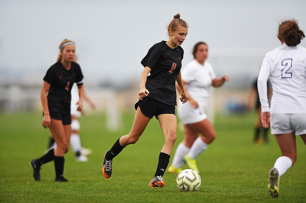 Flathead's Mia Stephan (11) pushes the ball towards the Butte goal in the first half at Kidsports Complex on Saturday. (Casey Kreider/Daily Inter Lake)