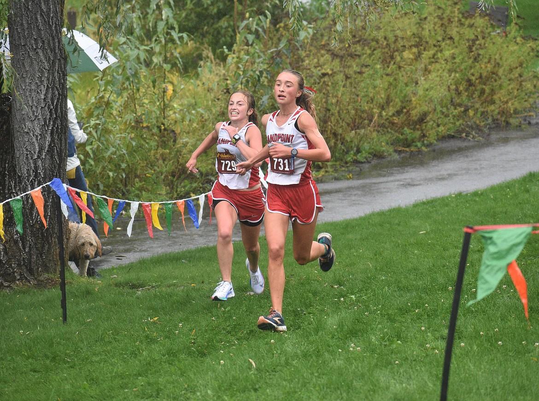 Camille Neuder (left) and Grace Rookey near the finish of Saturday's William Johnson Sandpoint Invitational.