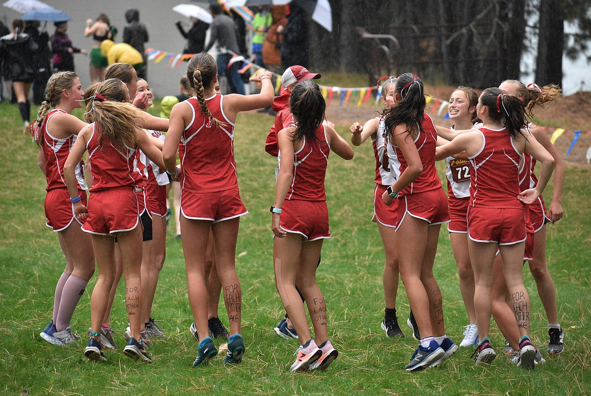 The SHS girls cross country team gets pumped up prior to the William Johnson Sandpoint Invitational on Oct. 10.