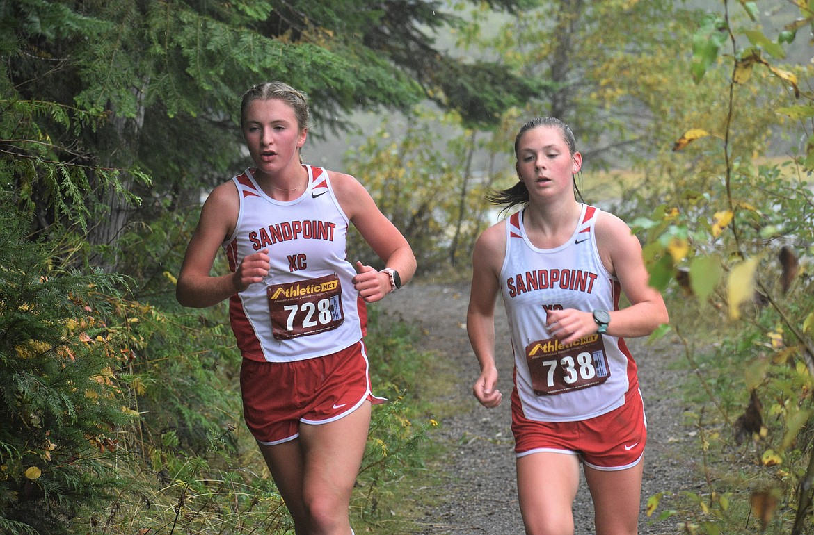 Annaby Kanning (left) and Quinn Hooper run side-by-side during Saturday's William Johnson Sandpoint Invitational.