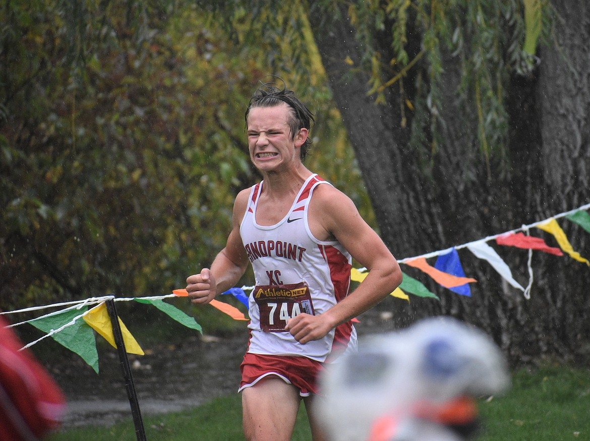 Sophomore Slate Fragoso grinds it out as he nears the finish line during Saturday's William Johnson Sandpoint Invitational.