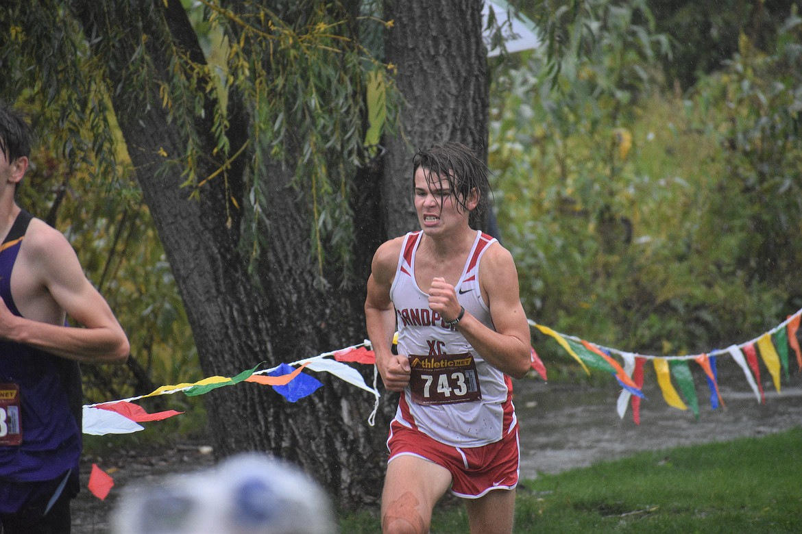 Junior Trey Clark digs deep as he nears the finish line of Saturday's William Johnson Sandpoint Invitational.