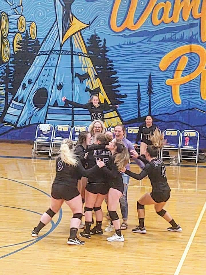 The Mullan Volleyball team celebrates after a big win on the road in Clark Fork.