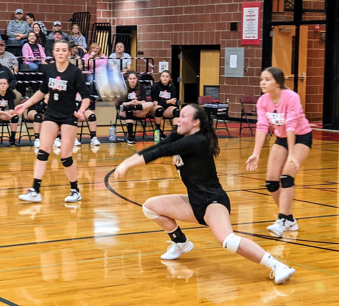 Miner Kendall Lohr Digs out a Wildcat hit during Dig Pink at WHS. The event is an annual cancer fundraiser between the Wallace and Kellogg volleyball teams.