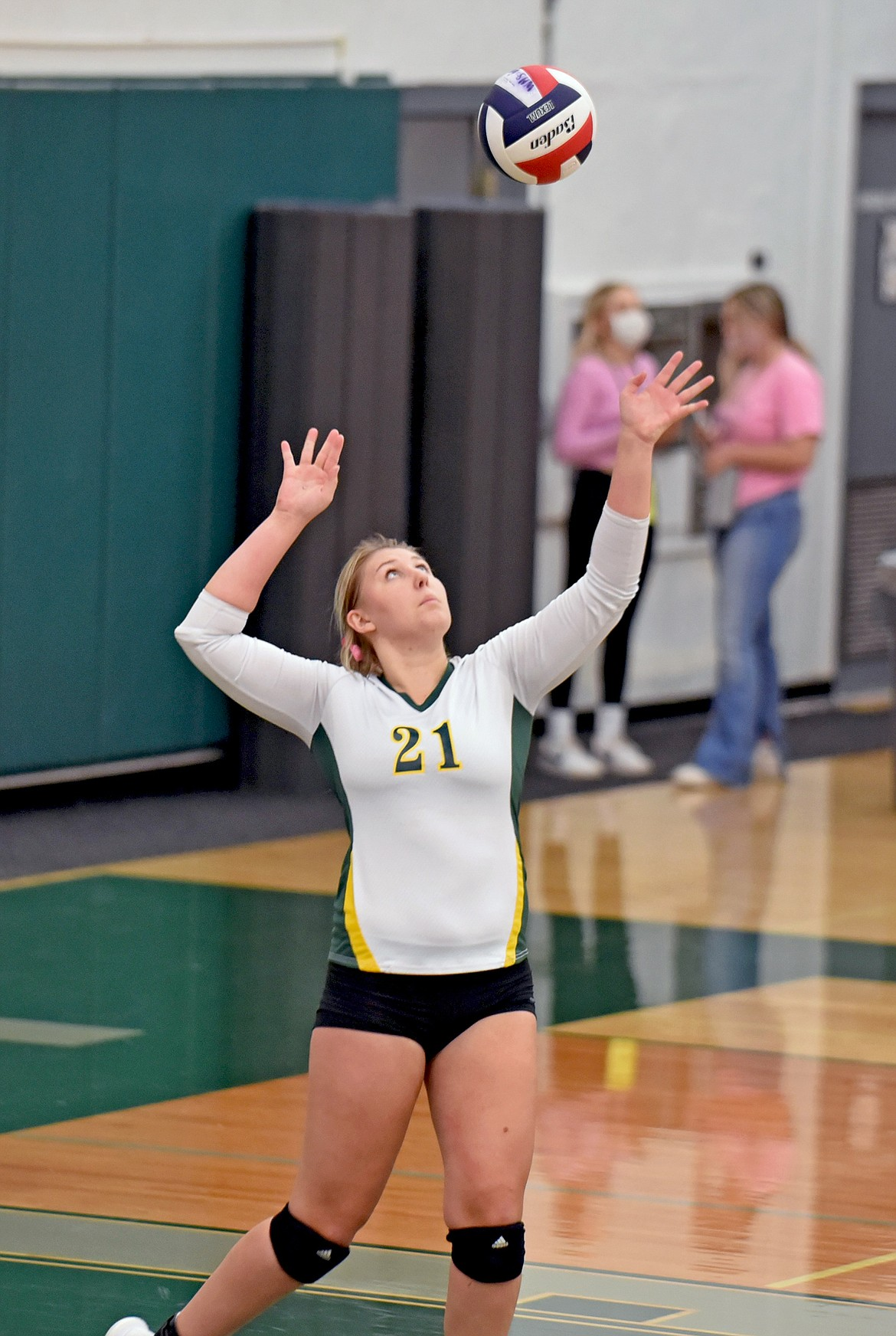 Whitefish senior Brook Smith lines up the ball as she serves in a match against Polson Tuesday, Oct. 6. (Whitney England/Whitefish Pilot)