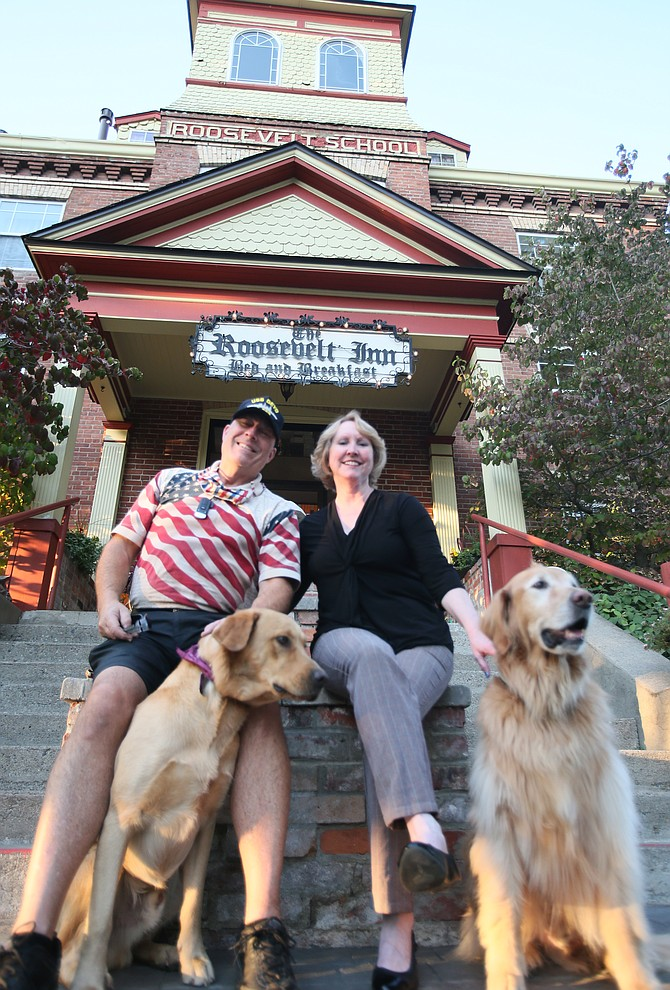 John and Tina Hough, in front of the Roosevelt Inn with pets Gondor and Rohan, are in the process of selling the historic bed and breakfast after 21 years. They're hoping the right buyer comes along within two years so they can retire and spend more time with the grandkids.