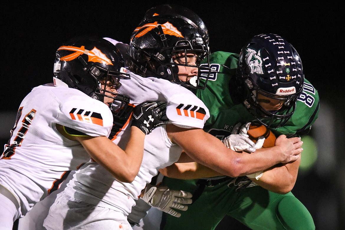 Glacier tight end Ethan Diede (80) is brought down by Flathead defenders on a third quarter reception  during crosstown football at Legends Stadium on Friday. (Casey Kreider/Daily Inter Lake)