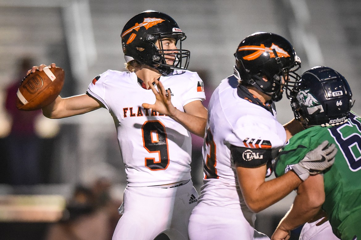 Flathead quarterback Charlie Hinchey (9) looks to throw in the first quarter against Glacier in crosstown football at Legends Stadium on Friday. (Casey Kreider/Daily Inter Lake)