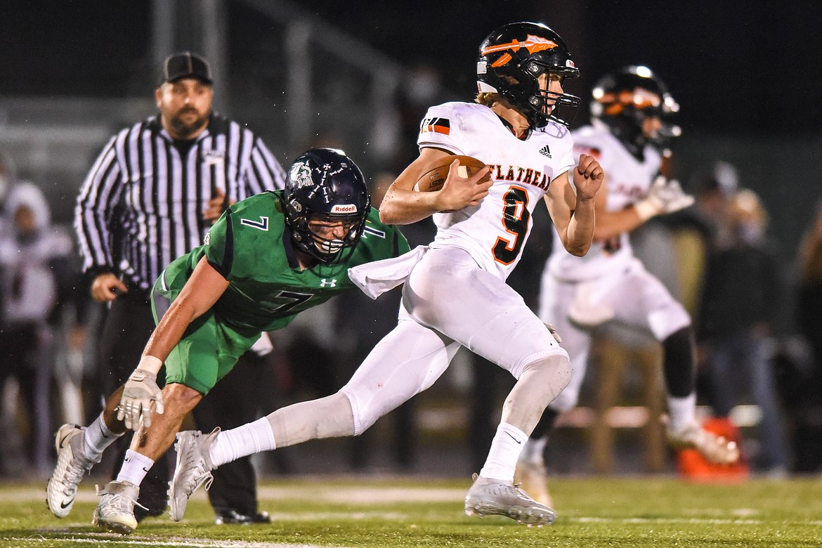 Flathead quarterback Charlie Hinchey (9) takes off upfield in the third quarter against Glacier during crosstown football at Legends Stadium on Friday. (Casey Kreider/Daily Inter Lake)