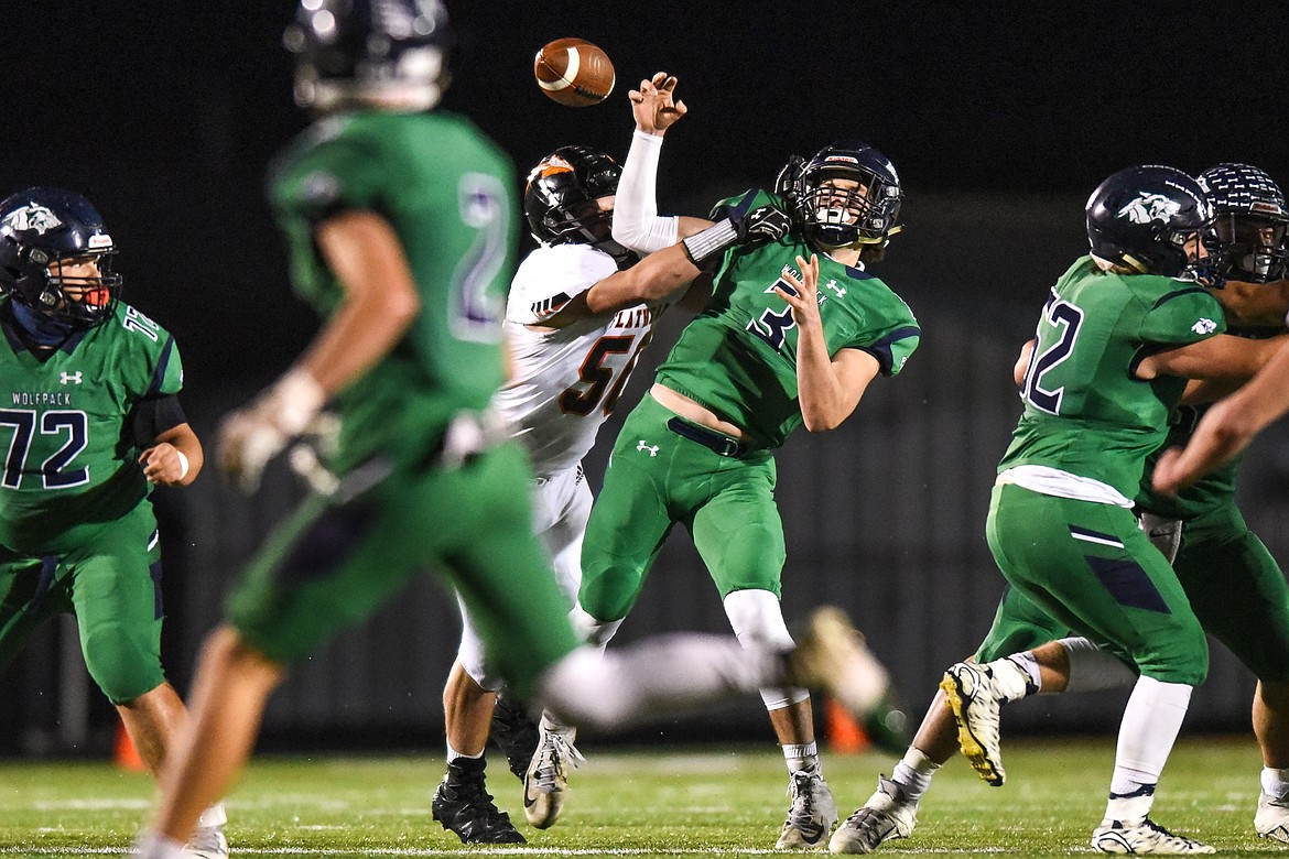 Flathead defensive lineman Elijah Owens (56) forces a fumble from Glacier quarterback JT Allen (3) in the third quarter during crosstown football at Legends Stadium on Friday. (Casey Kreider/Daily Inter Lake)