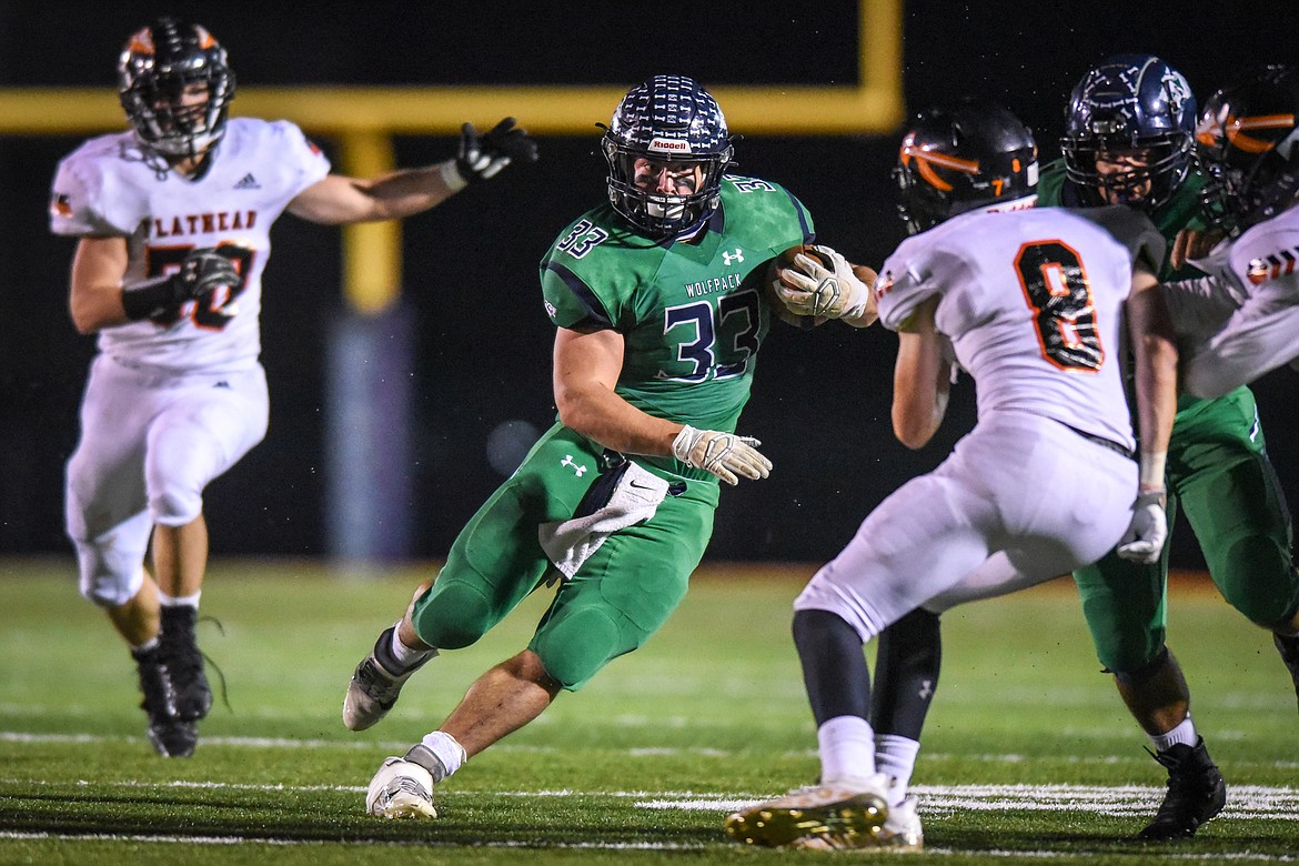 Glacier running back Jake Rendina (33) takes off on a 34-yard touchdown reception in the second quarter against Flathead  during crosstown football at Legends Stadium on Friday. (Casey Kreider/Daily Inter Lake)