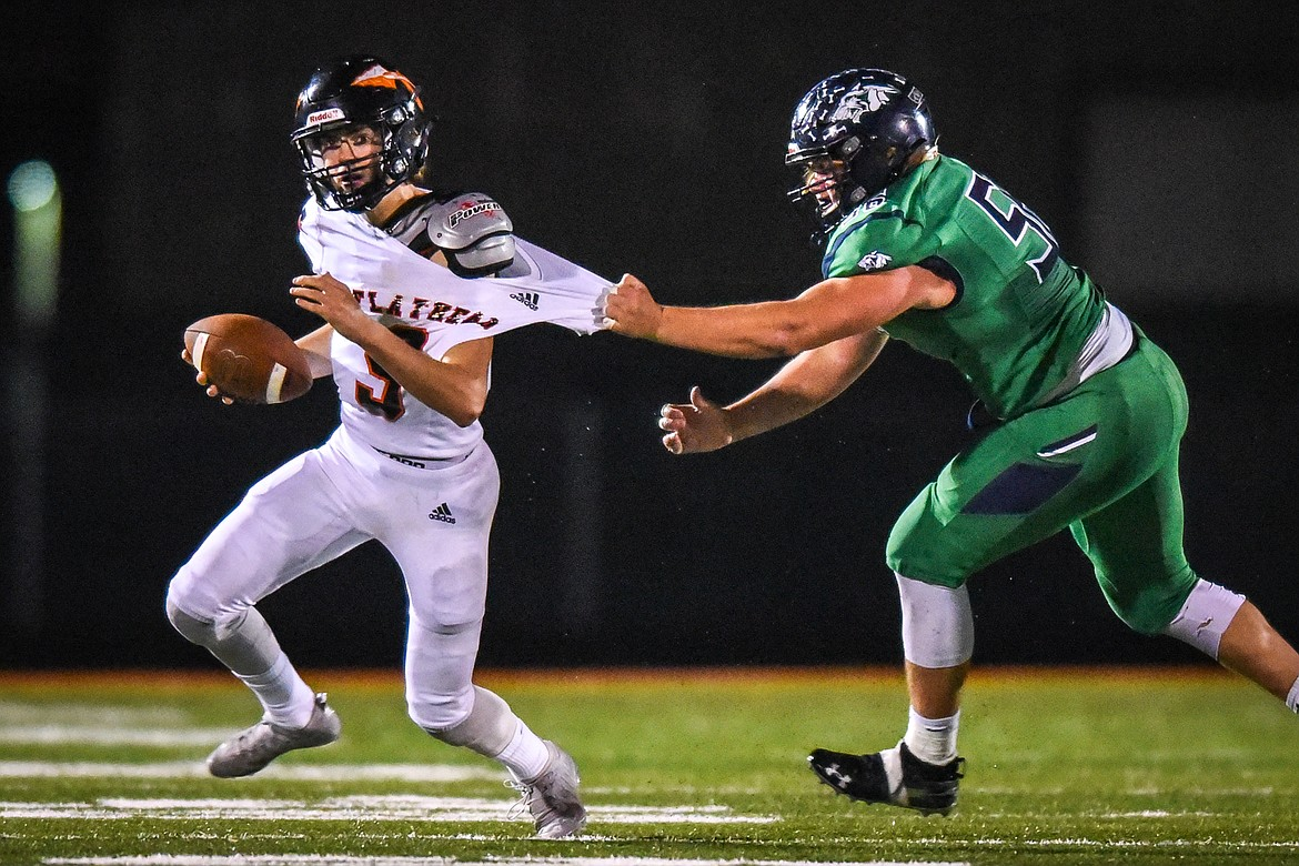 Glacier defensive lineman Rocco Beccari (56) sacks Flathead quarterback Charlie Hinchey (9) in the second quarter during crosstown football at Legends Stadium on Friday. (Casey Kreider/Daily Inter Lake)