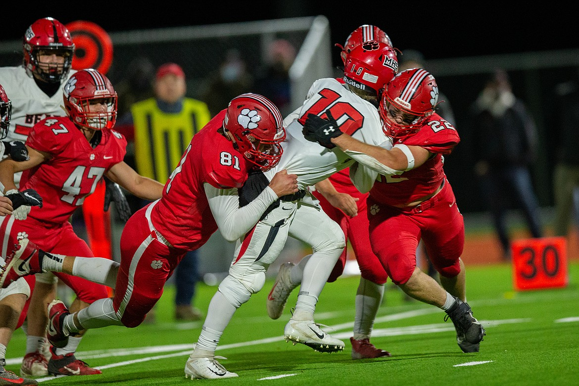 Will Hurst (left) and Tag Benefield (right) bring down a Moscow player on Friday night.
