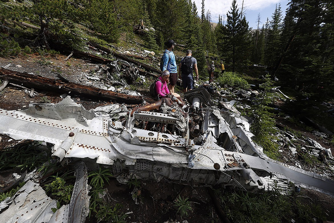 DAVID ZALUBOWSKI/Associated Press Relatives of members of the 1970 Wichita State University Shockers football team visit the crash site in July where an airplane carrying some of the players crashed near Loveland Pass, west of Silver Plume, Colo. Wreckage from the plane, which was one of two being used to take the Shockers to play a football game against Utah State University in Logan, Utah, is still scattered on the mountain top nearly 50 years after the crash close to the Eisenhower Tunnel.