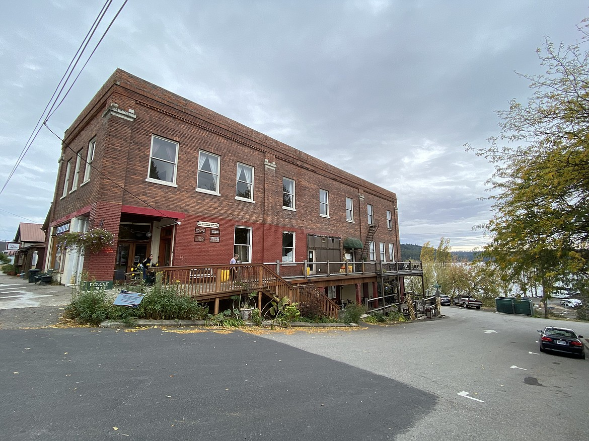 The Old Harrison Building is one of the few buildings that survived Harrison's 1917 fire that burned the majority of businesses and homes down. Now it is home to the Tin Cup breakfast and coffee shop, One Shot Charlie's bar and restaurant, and Simply Wilder Soap. (MADISON HARDY/Press)