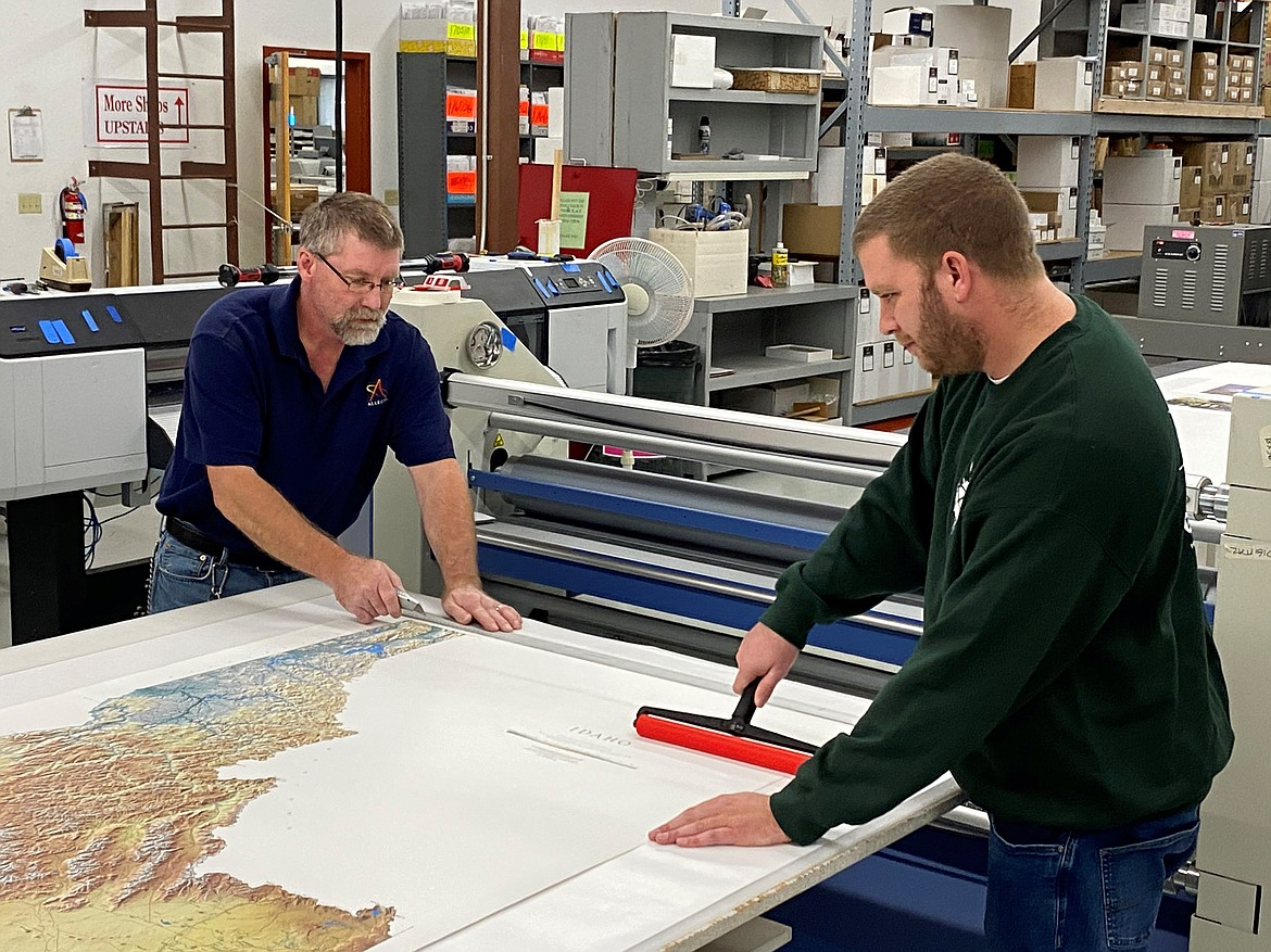 Darryl Frey and Carl Carter, wide format technicians for the digital color division of Allegra Marketing-Print-Mail in Coeur d'Alene, are two reasons the company keeps busy even when political season ends.