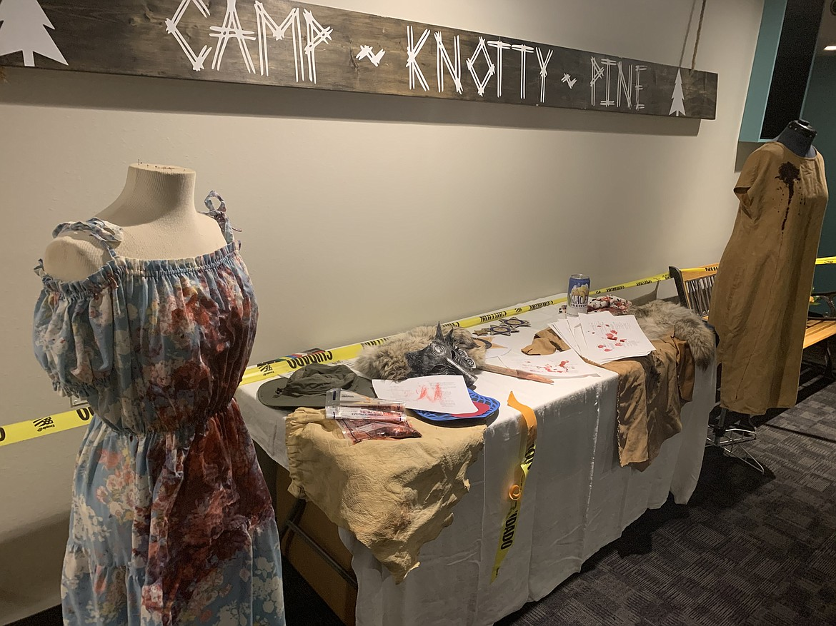 """A table lined with memorabilia from the set of """"Nexus of Evil"""" was arranged in the lobby of Showboat Stadium 6 on Thursday night during the film's premiere party. (Scot Heisel/Lake County Leader)"""