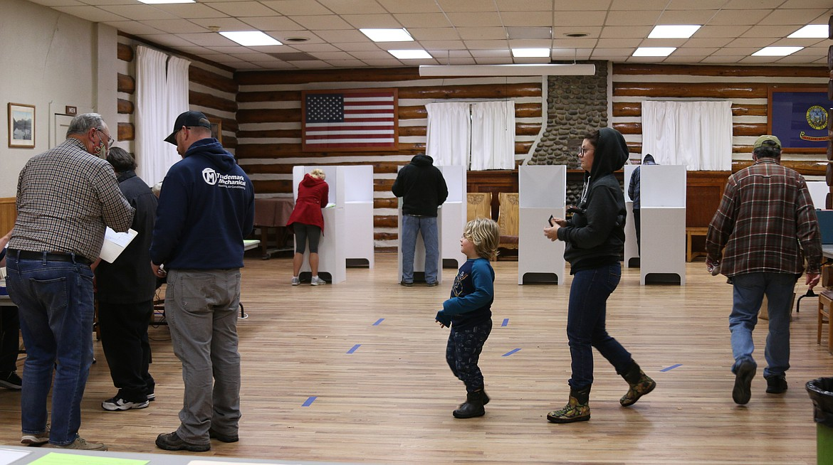 Residents line up to vote at the Sandpoint Community Hall to vote Tuesday night.