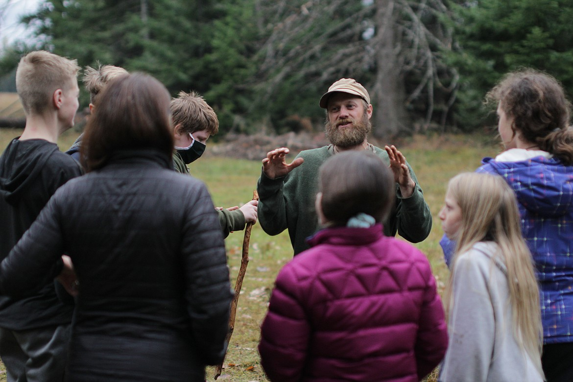 Dave Kretzschmar talks to students at Pine Street Woods Wednesday afternoon.