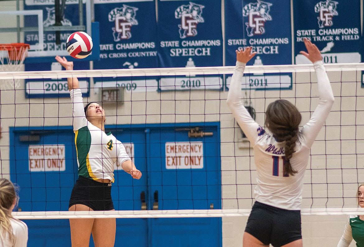 Bulldog junior Emma Trieweiler hits the ball over the net against the Wildkats last week in Columbia Falls. (Chris Peterson/Hungry Horse News)
