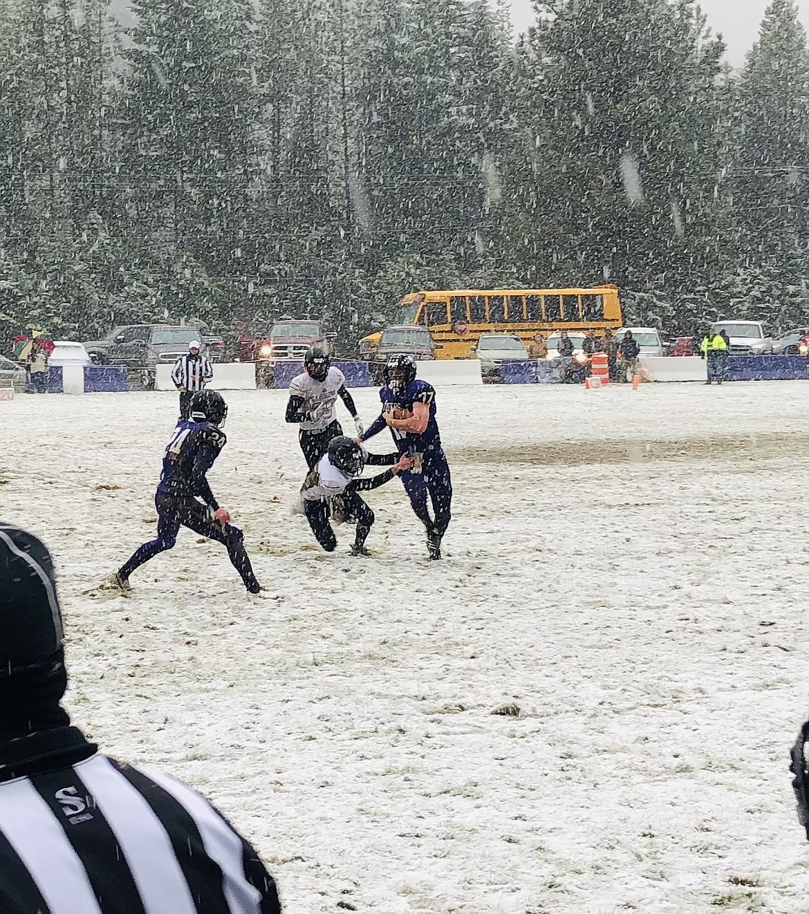 Adam Ball stiff arms a Horseshoe Bend defender during an early run in their playoff game last weekend.