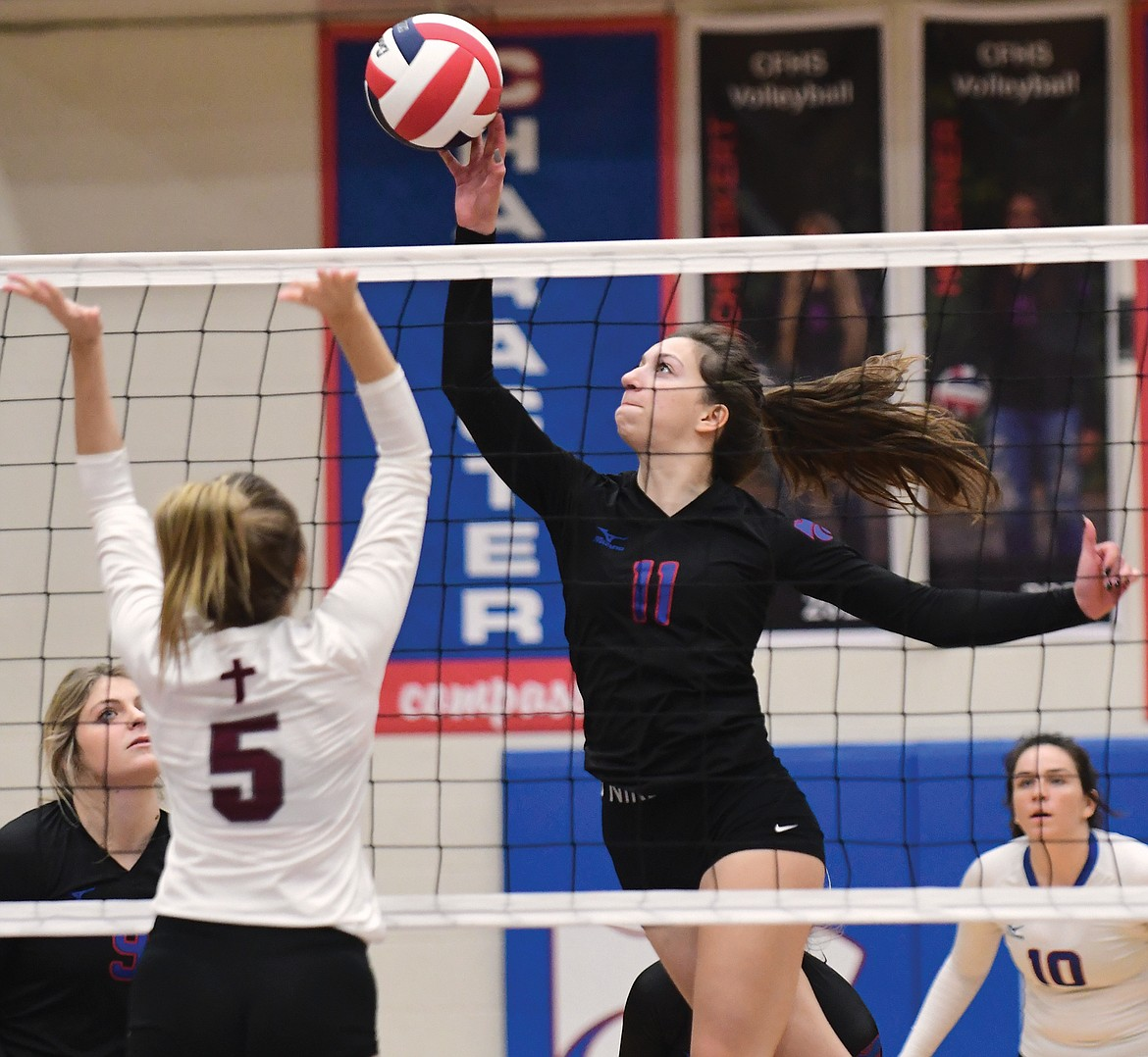 Jazzy Marino taps the ball over the net against Central on Thursday. (Teresa Byrd/Hungry Horse News)