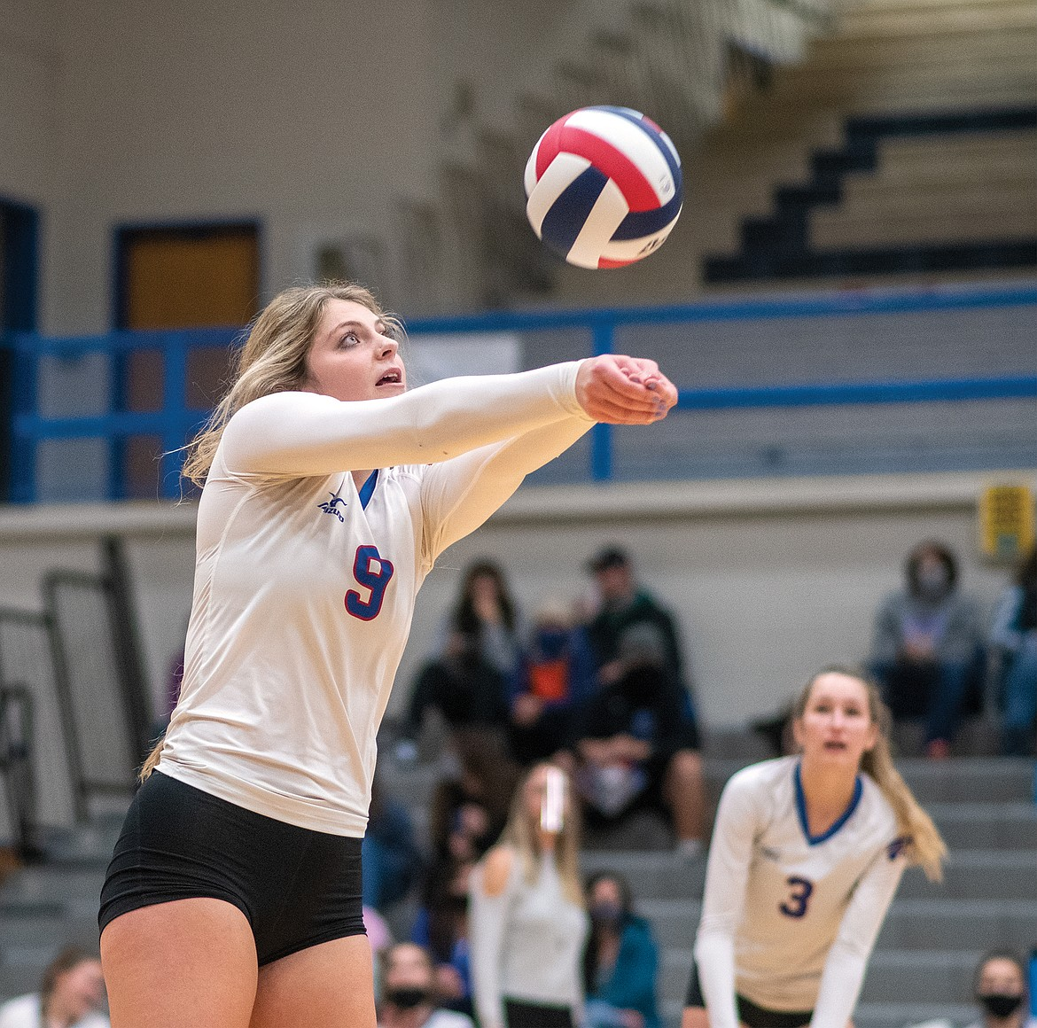 Hannah Schweikert bumps the ball in the divisionals semifinal match against Whitefish on Friday. (Chris Peterson/Hungry Horse News)