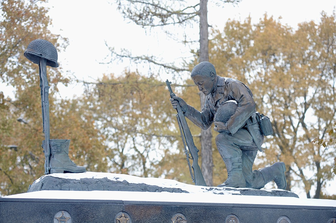 The Veterans Memorial is coated with fresh snow during a Veterans Day ceremony Wednesday, Nov. 11, at Depot Park in Kalispell. (Matt Baldwin/Daily Inter Lake)