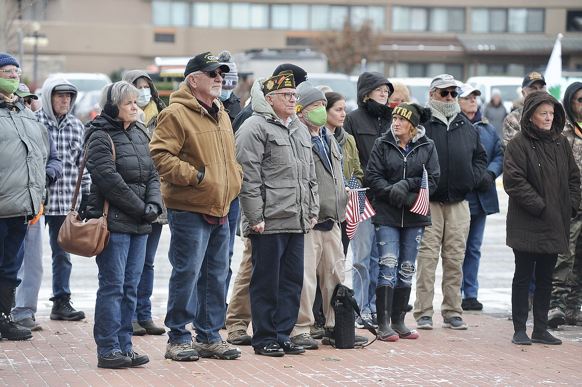 People gather for a Veterans Day ceremony Wednesday, Nov. 11, at Depot Park in Kalispell. (Matt Baldwin/Daily Inter Lake)