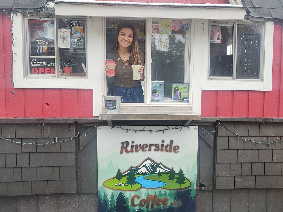 Courtesy photo Barista Jul Flanagan is shown at the Riverside Coffee drive-through stand at 6707 E. Seltice Way.
