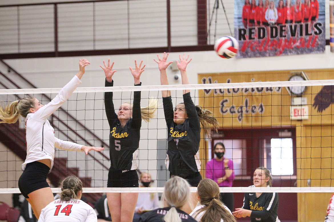Polson's Hallie Moss (5) and Liz Tolley (7) defend a shot from a Glendive player at the class A state tournament in Sidney. (Dillan Schorfheide/Sidney Herald)