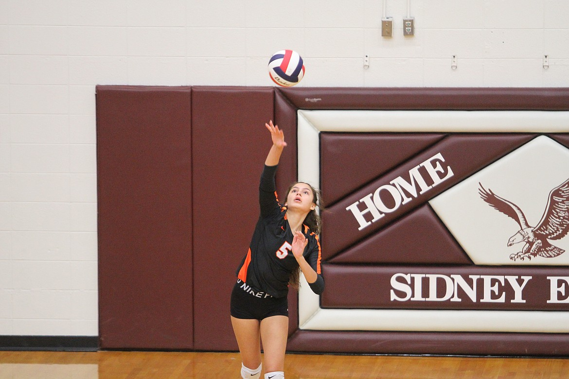 Ronan's LaReina Cordova hits a serve against Billings Central on Friday. (Dillan Schorfheide/Sidney Herald)
