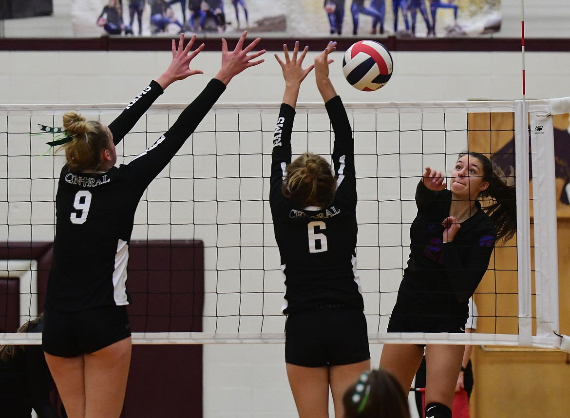 Mady Hoerner with a trademark kill against Central during the championship. (Teresa Byrd/ Hungry Horse News)